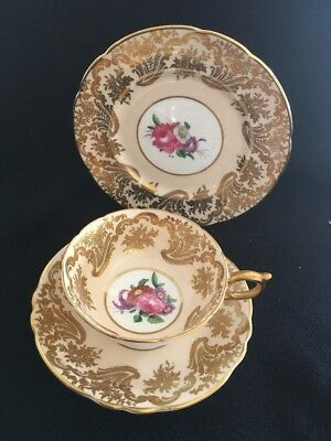 PARAGON VINTAGE BONE CHINA TRIO Heavy gilt decoration
