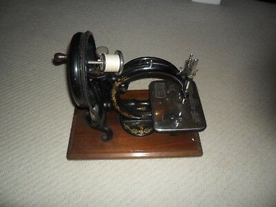 A very good Wilcox & Gibbs Sewing Machine with  box