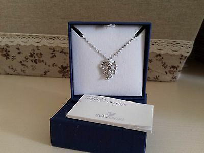 swarovski Angel necklace with Authenticity certificate, never used