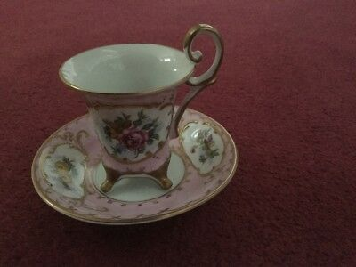 Antique Limoges hand decorated cup and saucer on legs.  Pink and white.