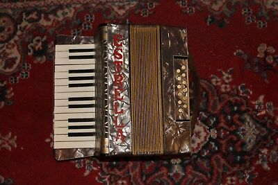 Estrella Piano Accordian 2 Octave right hand 12 button left hand used but plays