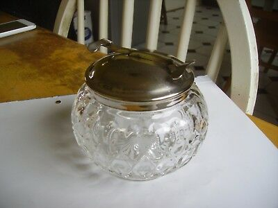 Antique pressed patterned glass sugar bowl with integral scissor tongs.