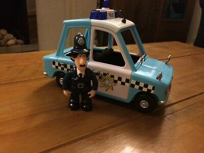 postman pat- p.c Selby and police car.