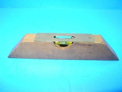 small unmarked wood level w/ brass top plate