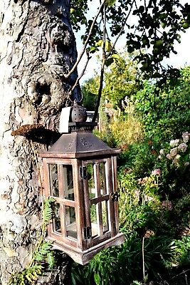 Acorn detail small wooden candle lantern with metal fastener for indoors or out.