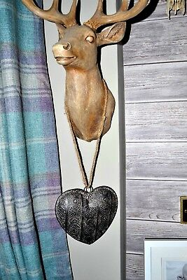 Ornamental metal heart on a natural rope