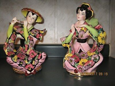 Vintage Italian made Porcelain Oriental Man Playing Flute and Geisha woman
