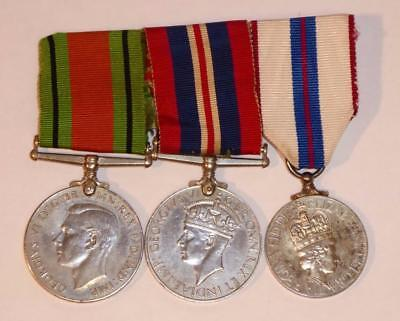 Pair Of Ww2 Medals Plus The Queens Silver Jubilee Medal. All Ribboned On Bar