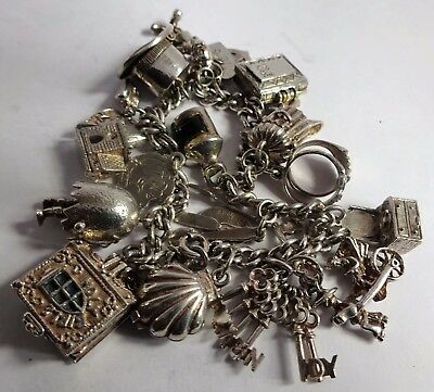 Amazing vintage solid silver charm bracelet & 18 silver charms (rare, move,open)