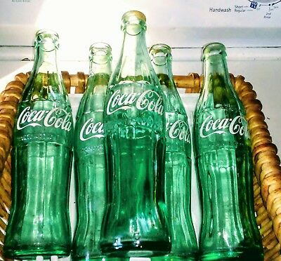 Lot of five vintage coca cola bottles 10 oz.