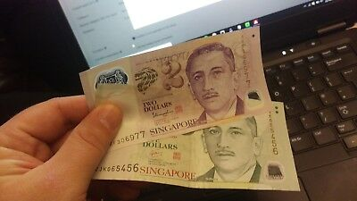 8.50 Singapore Dollars (SGD), 5 + 2 dollar notes in plastic + coins
