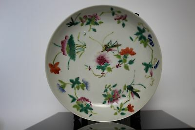 A Chinese famille rose dish with grasshoppers & flowers bat & peach mark to base