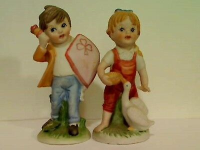 """Ceramic Boy With Bell/Shield Girl With Basket/Goose Figurines 5"""" Tall"""