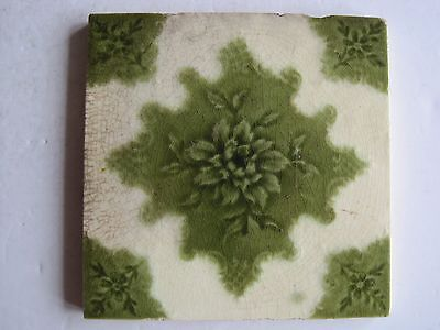 Antique Victorian Moulded And Glazed Wall Tile - Green Flower  On Cream
