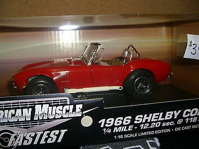 1/18 ERTL 1966 Shelby Cobra, 10 fastest in red with white pipes.