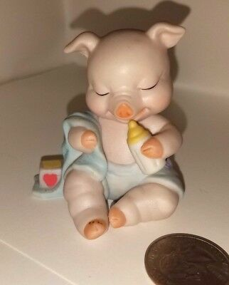 Sitting Pig with baby bottle & blue blanket, ceramic, 1994, stamped, dated
