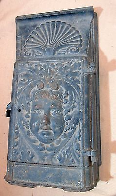 rare antique 1800's thick cast iron figural cherub fireplace stove door cover