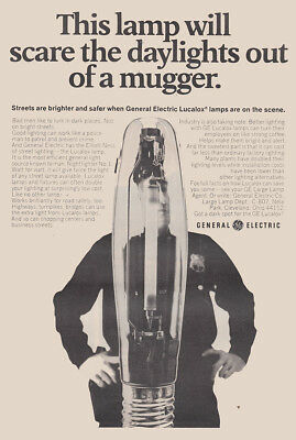 1969 General Electric: Scare the Daylights Out of a Mugger Vintage Print Ad