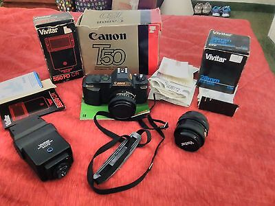Canon T50 Camera Vivitar 28 MM lens 550 FD c/r Flash Lot In boxes Booklets