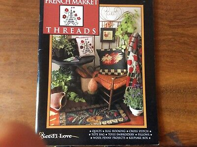 "BOOK ""FRENCH MARKET THREADS"" featuring quilts,rug hooking,cross stitch ,pillows,"