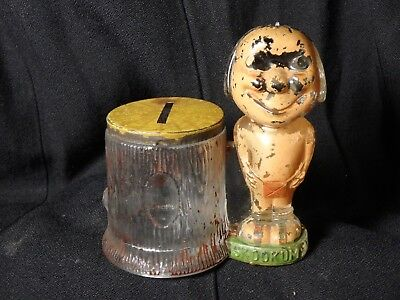 1910's Skookum Doll Still Bank Candy Container Original Paint and Litho Tin Lid