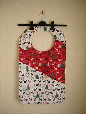 Adult Bib in a White and Red Christmas Themed Material