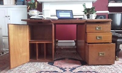 Mahogany and brass partners desk with inlaid formica top. Three drawers.