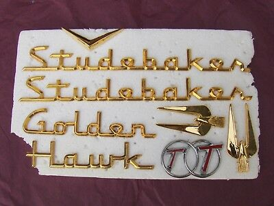 1957 STUDEBAKER Golden Hawk EMBLEMS.. INSIGNIA....Purchased NEW.. Complete SET