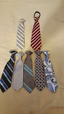 Boys lot of 7 neck ties $5 a piece or $27 for all 7, 1 zip tie, others clip on