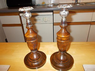 pair of antique candlesticks with ornate sconces