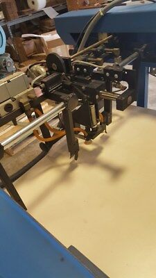 D & K laminator feeder and slitter