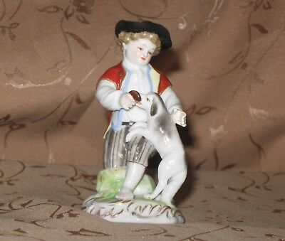 Small Porcelain Figurine Of A Young Boy Playing With A Dog