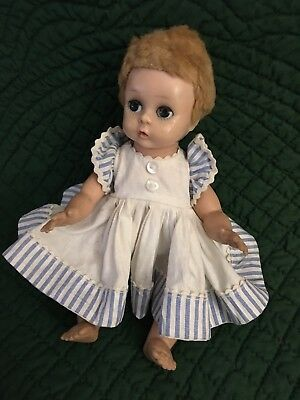 Vintage 1950s Madame Alexander LITTLE GENIUS WALKER DOLL. Tagged Outfit
