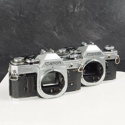 # Lot of Two Canon AE-1 Bodies **PARTS** 902