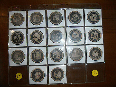 Collection Of 17 Silver Jubilee Playboy Wooden Nickels