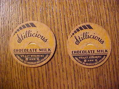 "(2) old STILLICIOUS chocolate milk caps marked ""30 Sherman Units per quart"""