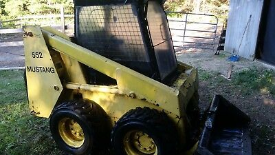 Mustang 552 Skid Steer with backhoe and auger attachments