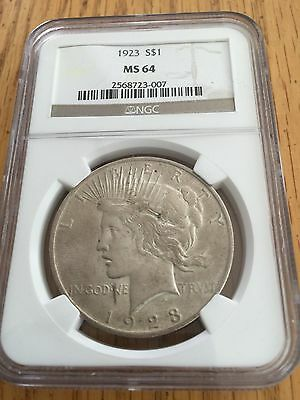 1923 Silver Peace Dollar NGC MS 64 Toning started