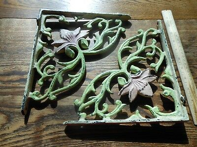 Vintage cast  iron shelf brackets painted w/flower