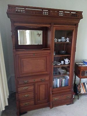 Antique solid cherry desk/bookcase with brass hardware & ornate toprail