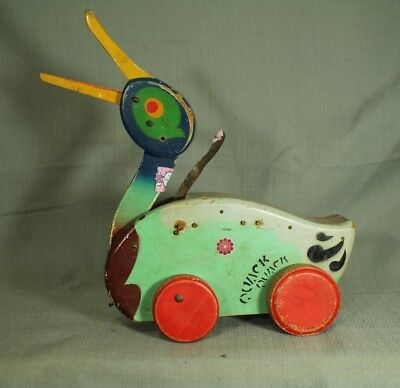 Quack Quack vintage antique  old wood toy duck on wheels  pull toy  mechanical
