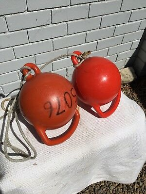 Old Pair Of Red Sailing Buoys
