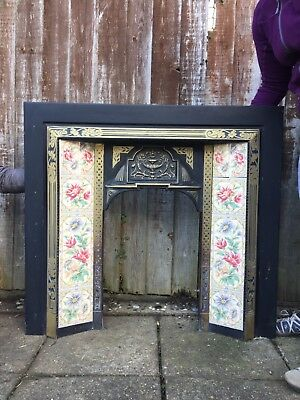 Victorian style fireplace with decorative tiles. Used but in good condition