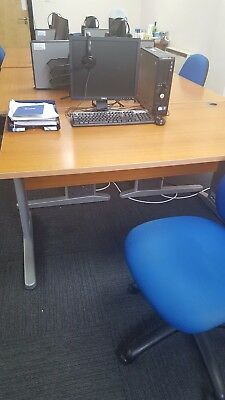 5 desks and 5 blue office chairs. 35.00 each set of 1 desk and 1 chair.