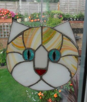 Hand crafted glass, cats head sun catcher made using copper foiling