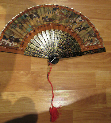 Vintage womens hand held fan Asian wood cloth laquered black brown red tassle