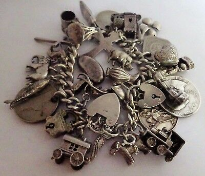 Gorgeous vintage solid silver charm bracelet & 29 lovely charms,move/open. 90.2g