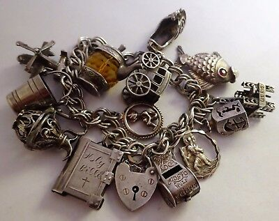 Super vintage solid silver charm bracelet &charms.Rare wolf whistle & girocopter