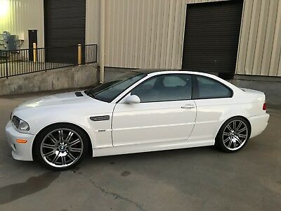 2002 BMW M3  2002 BMW E46 M3 Alpine white on Black 6sp Coupe with CSL Carbon Roof.