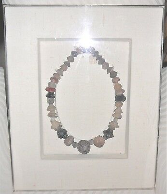 Pre-Columbian spindle whirl coin terracotta necklace. Framed in shadowbox